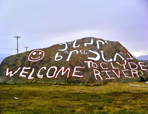 A dressed up rock welcoming visitors to Clyde River